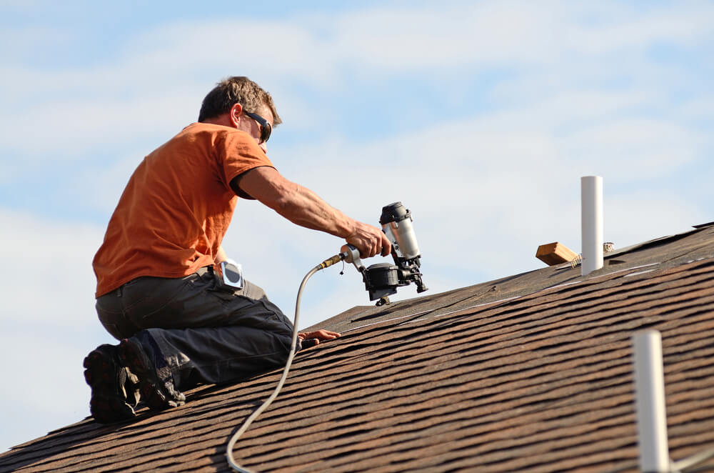 A roofing contractor at work